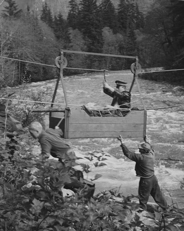 Hiker Alick Patterson assisted from Seymour Mountain, 1956.
