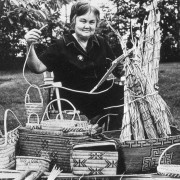 Eva Nahanee with basketry work, 1970s. NVMA 2506