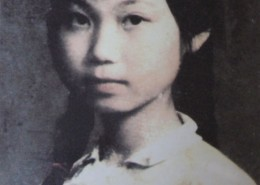 Portrait of a young girl, with a button in honour of Mao Zedong pinned to her chest.