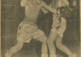 Newspaper clipping showing two aboriginal boys boxing.