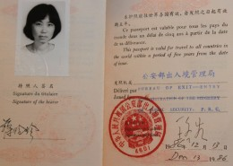Alice's passport, open to her photograph and signature.