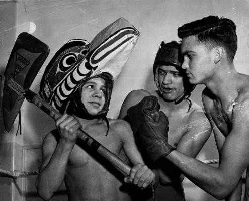Three members of the boxing club, one wearing a dance mask; two others in boxing gear.