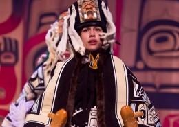Teenage girl dressed in traditional aboriginal regalia.