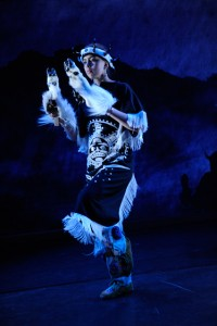 Teenage girl dancing in Gitxsan mountain goat regalia.