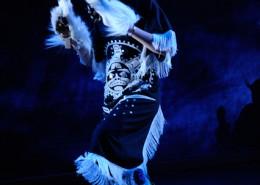 Teenage girl dancing in Gitxsan mountain goat regalia.