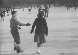 Yvonne skating with a boy at an outdoor rink.