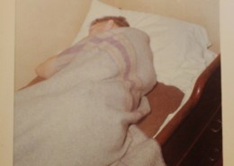 Colour snapshot of the chief engineer asleep on a bunk.