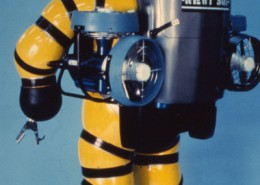 Back view of a yellow atmospheric diving suit.