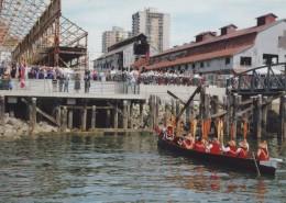 Squamish canoe and paddlers at celebration marking opening of Burrard Drydock Pier.