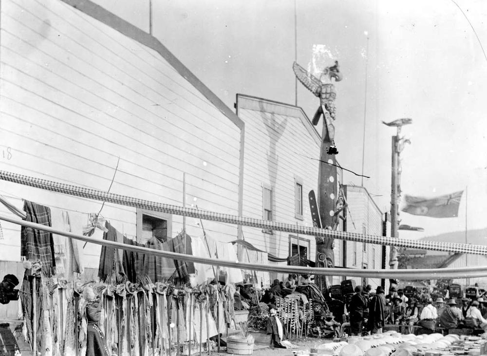 A display of articles to be given away at a potlatch, Alert Bay. Photo: BC Archives H-03975