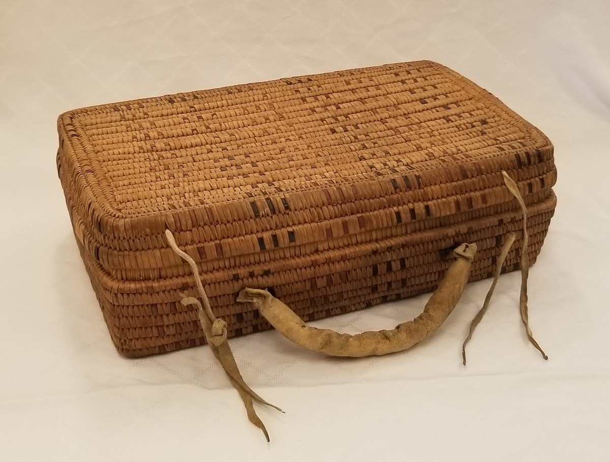 This cedar briefcase woven using the Coast Salish split-root coil technique was purchased for the NVMA collection in 2016. Photo: Karen Dearlove