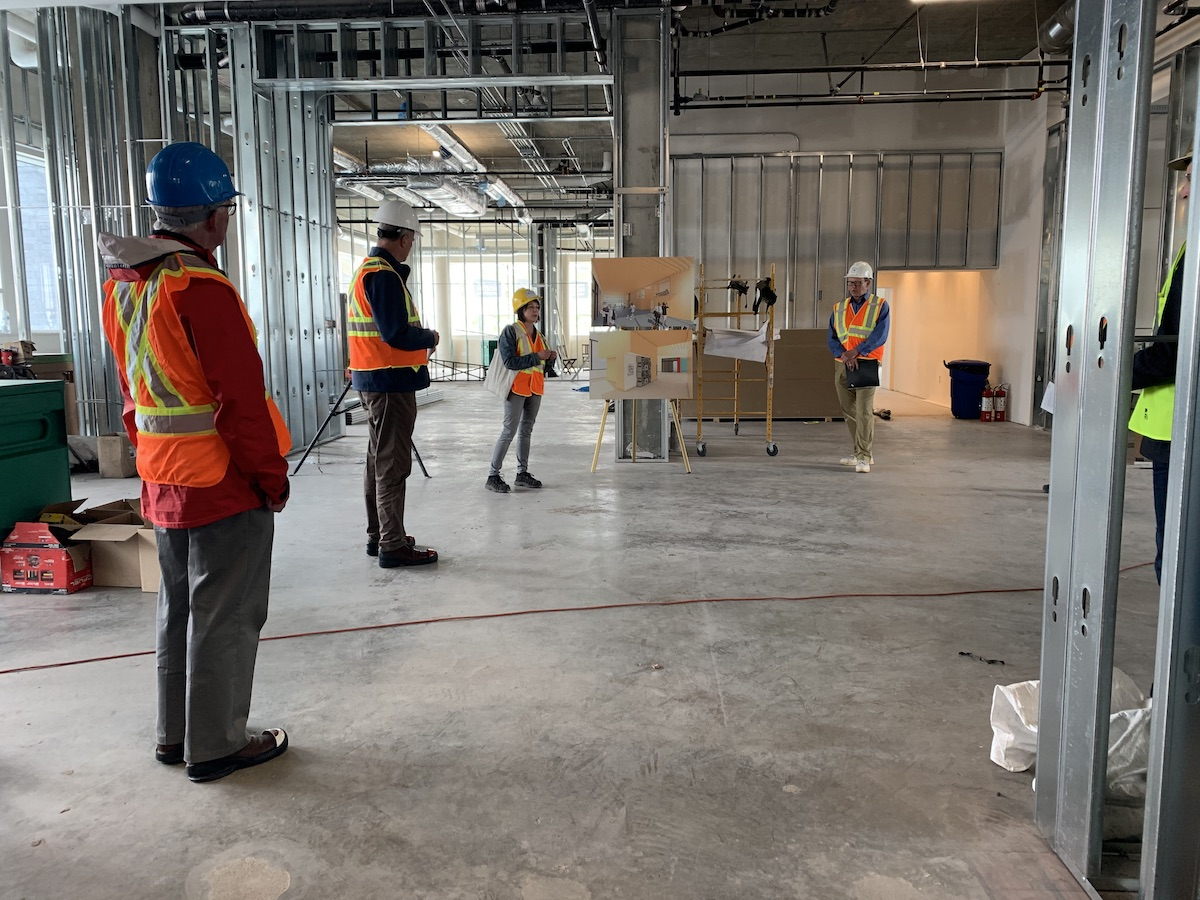 Curator Karen Dearlove and Director Wesley Wenhardt lead a group of community supporters through the new Museum on a break from construction on June 3, 2020. Photo: Stephen Irving