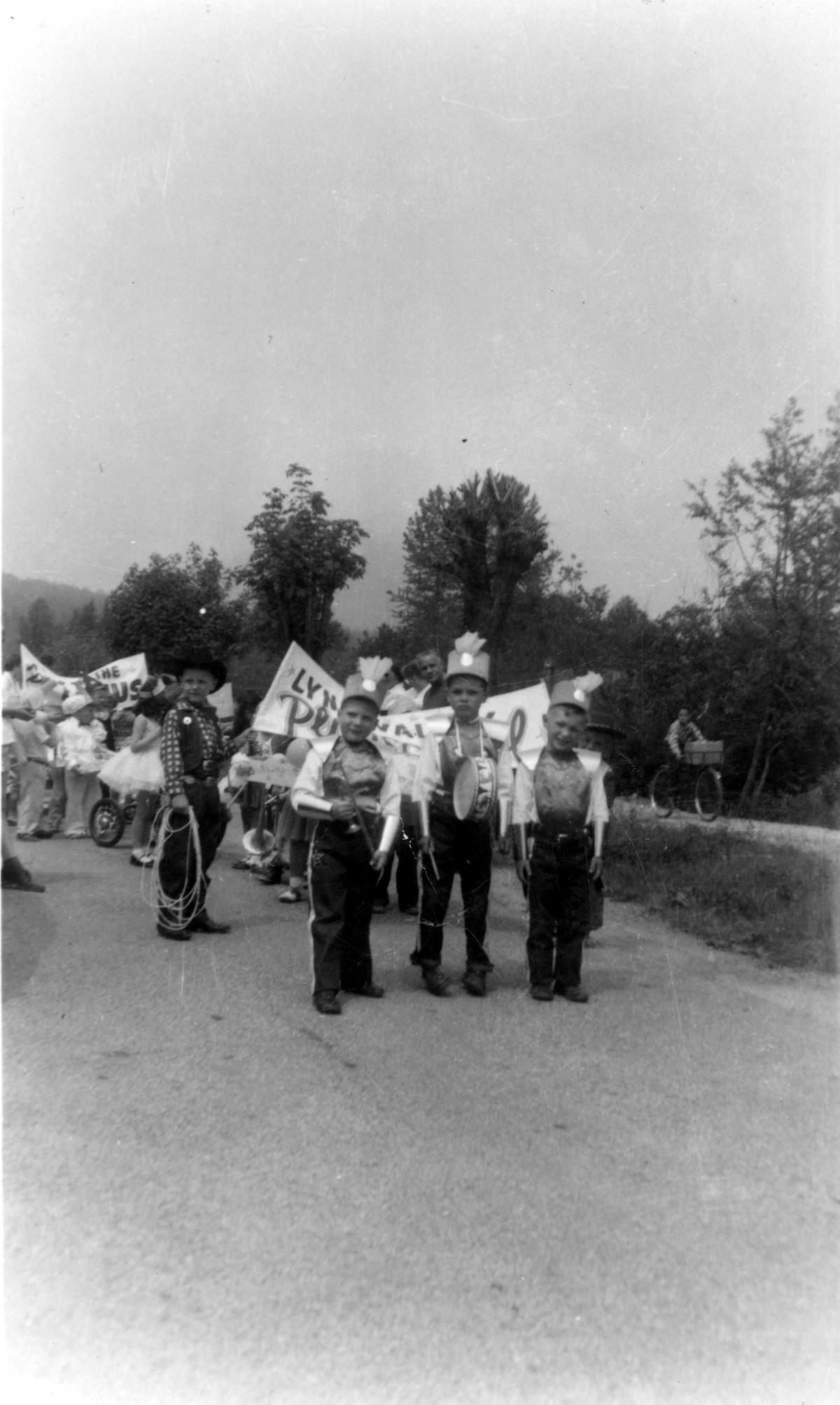 Lynn Valley Day Parade of Children, 1957. The Bearded Lady at left. Item: 11382.
