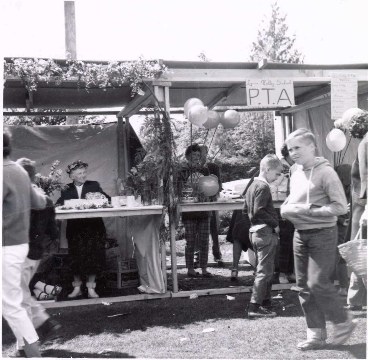 Lynn Valley Day, Norma McLennan in booth, 1967. Item: 26-19F-21.