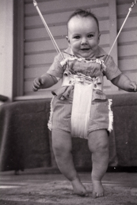Tracy (Poole) Braiden, granddaughter of Olivia Poole, using an early version of the Jolly Jumper, May 1958. Photographer Elizabeth Poole, NVMA 14771.