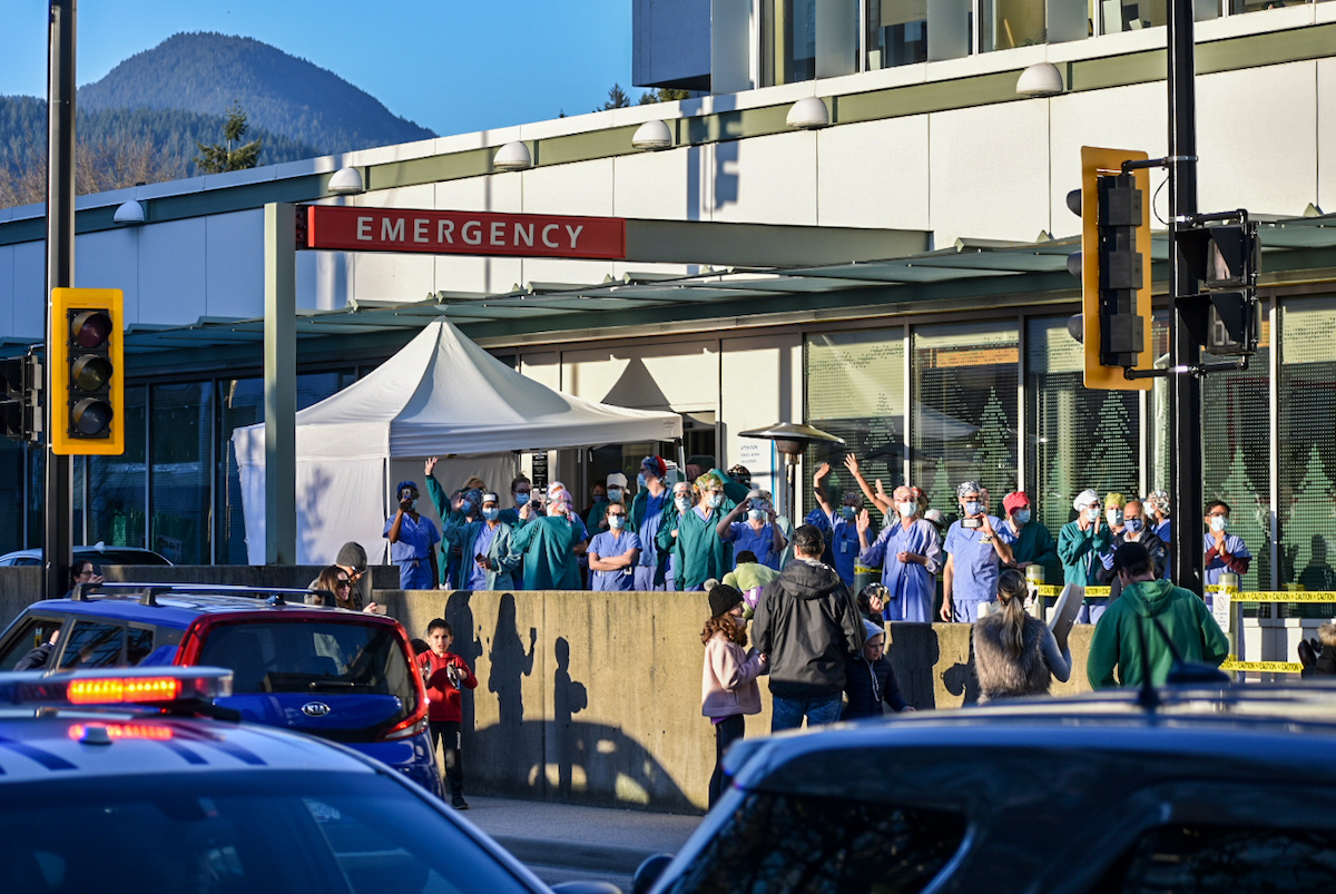 Sutherland Secondary School student Jackson Waller submitted this image of healthcare workers at Lions Gate Hospital taking a moment to be a part of the 7pm Cheer. Photo: Jackson Waller