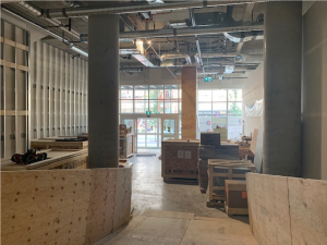 The front lobby of the Museum, looking north to the front entrance with Streetcar 153 protected behind boards on the right. The crates contain elements of the Museum's core exhibits, ready to be installed.
