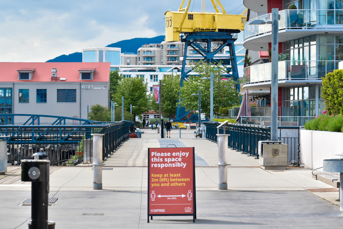 Physical distancing signs like this one in the Shipyards District are now ubiquitous in public spaces across North Vancouver. Photo: Jackson Waller
