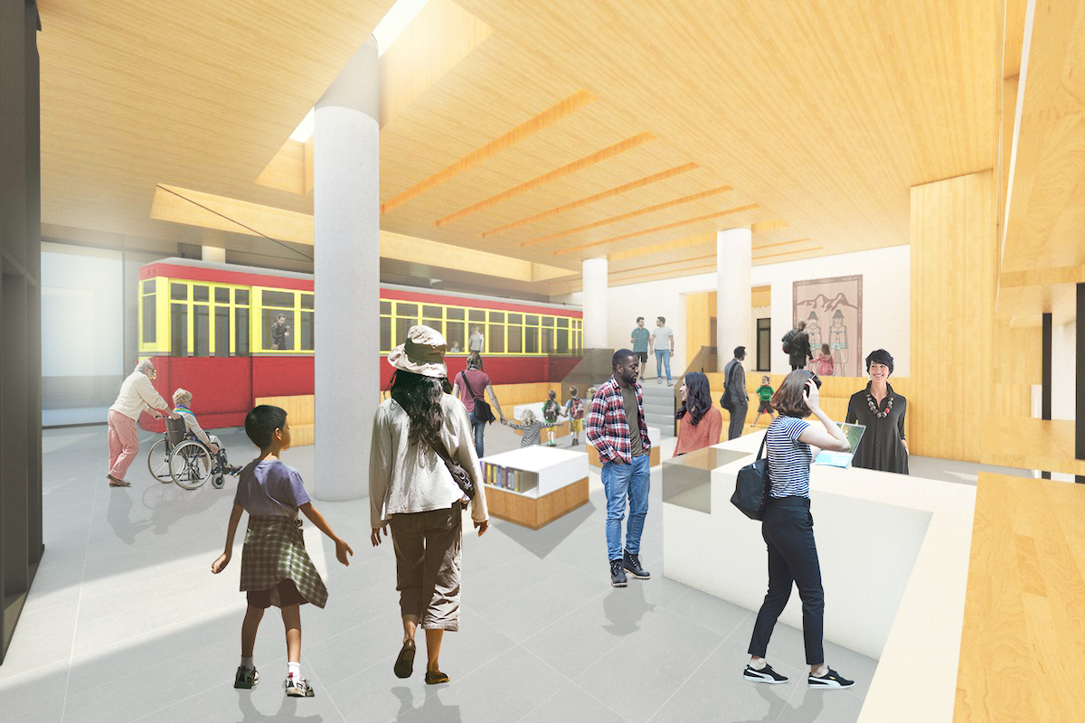 Interior rendering of the new Museum lobby, which will feature a restored Streetcar 153 and Wade Baker's Sch'ich'iyuy (The Two Sisters) cedar carving.