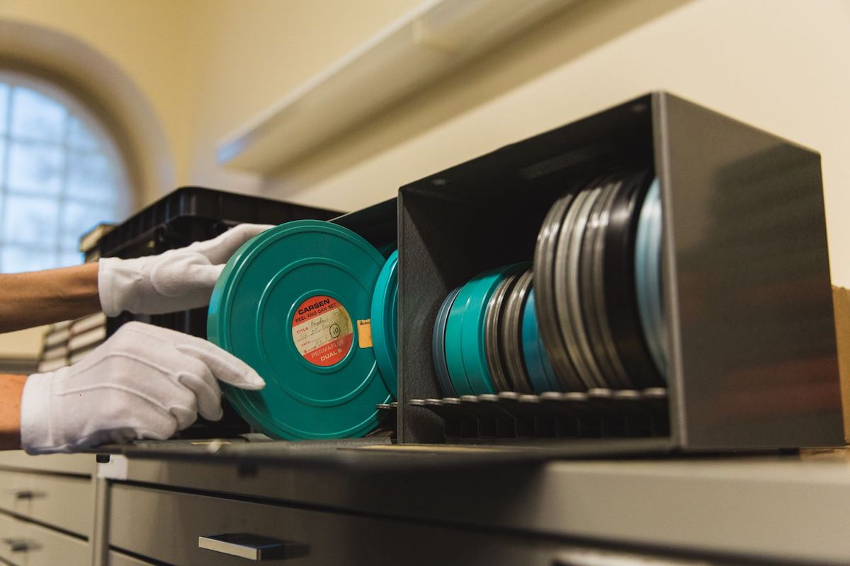 An image of someone pulling out film reels in the Archives of North Vancouver collection. Photo: Alison Boulier