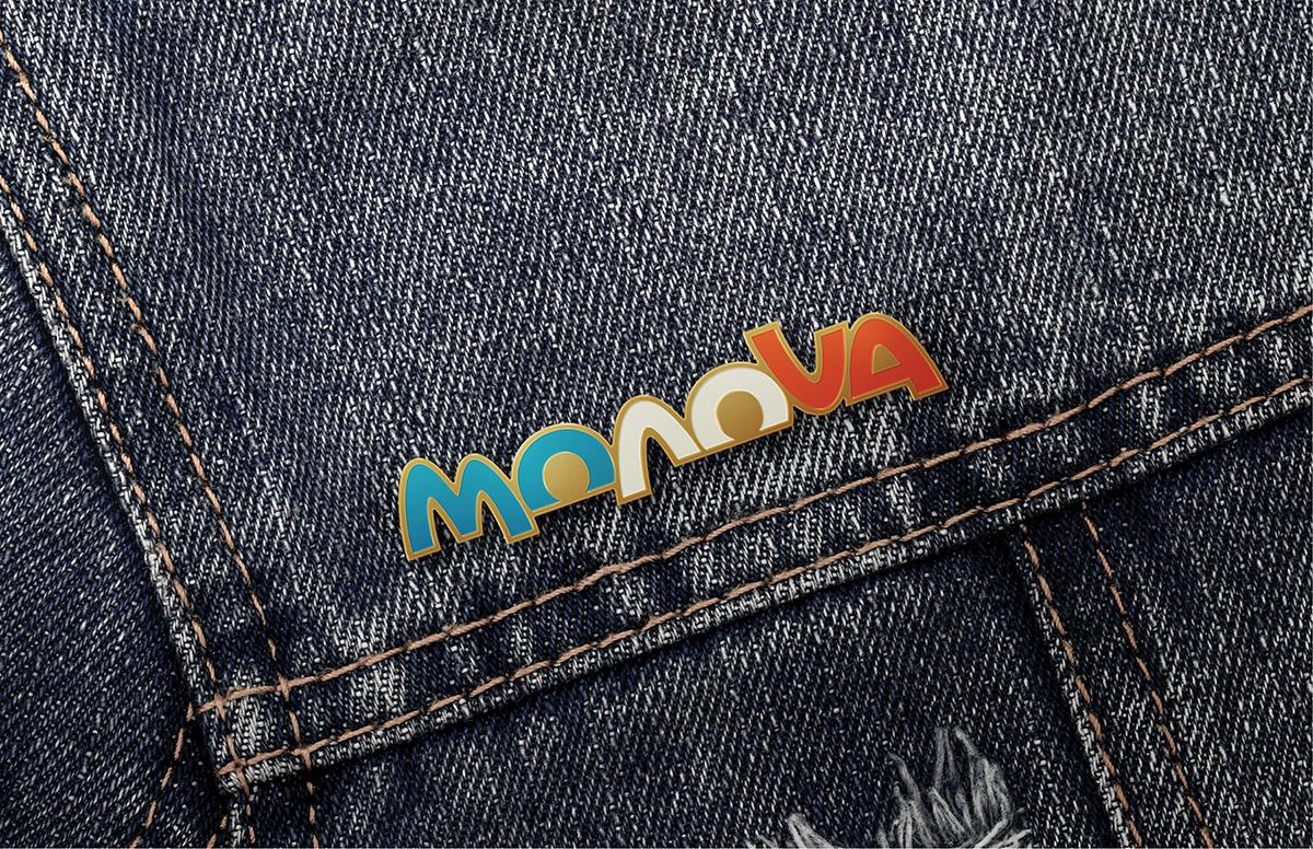An image of a MONOVA lapel pin on a denim shirt. A concept for future merchandise at the MONOVA Gift Shop.