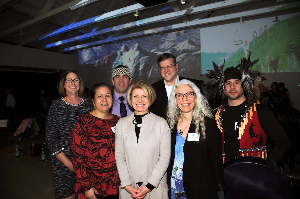 """A community of support at the North Shore Culture Compass Reveal, March 12, 2020. Back row, left to right: CNV Mayor Linda Buchanan; SYETÁXTN, Chris Lewis, Squamish Nation Councillor & Spokesperson; DNV Mayor Mike Little, Tsleil-Waututh Nation Ambassador Dennis Thomas """"Whonoak"""". Front row, left to right: Tsleil-Waututh Nation Councillor Deanna Bridgit George, Halat Tewalewet; DWV Mayor Mary-Ann Booth; North Van Arts Executive Director Nancy Cottingham Powell. Photo: Mike Wakefield"""