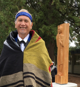 Artist Latash Maurice Nahanee with Welcome Figure. Photo: District of North Vancouver