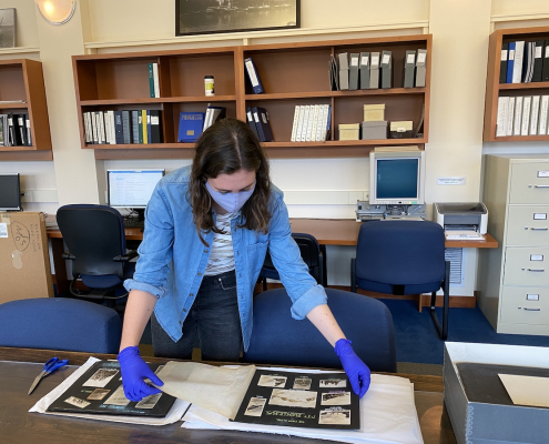 Archives and Community Engagement Intern, Nina Patterson preserving one of Neal Carter's albums, March 2021.