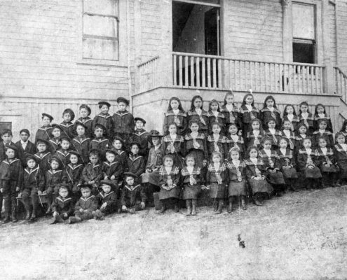 Primary pupils outside St. Paul's Indian Residential School at 541 W. Keith Road, c. 1905. Photo: NVMA 4839