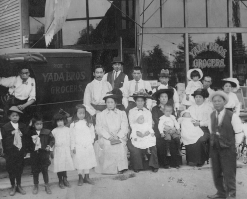 Yada family and relatives in front of Yada Bros. Grocers at 701 E. 4th St., ca. 1913. Finding myself reflected in the archives, means to see members of a racially persecuted Japanese Canadian community. MONOVA Archives, NVMA 9532. Yada family and relatives in front of Yada Bros. Grocers at 701 E. 4th St., ca. 1913. Finding myself reflected in the archives, means to see members of a racially persecuted Japanese Canadian community. MONOVA Archives, NVMA 9532.
