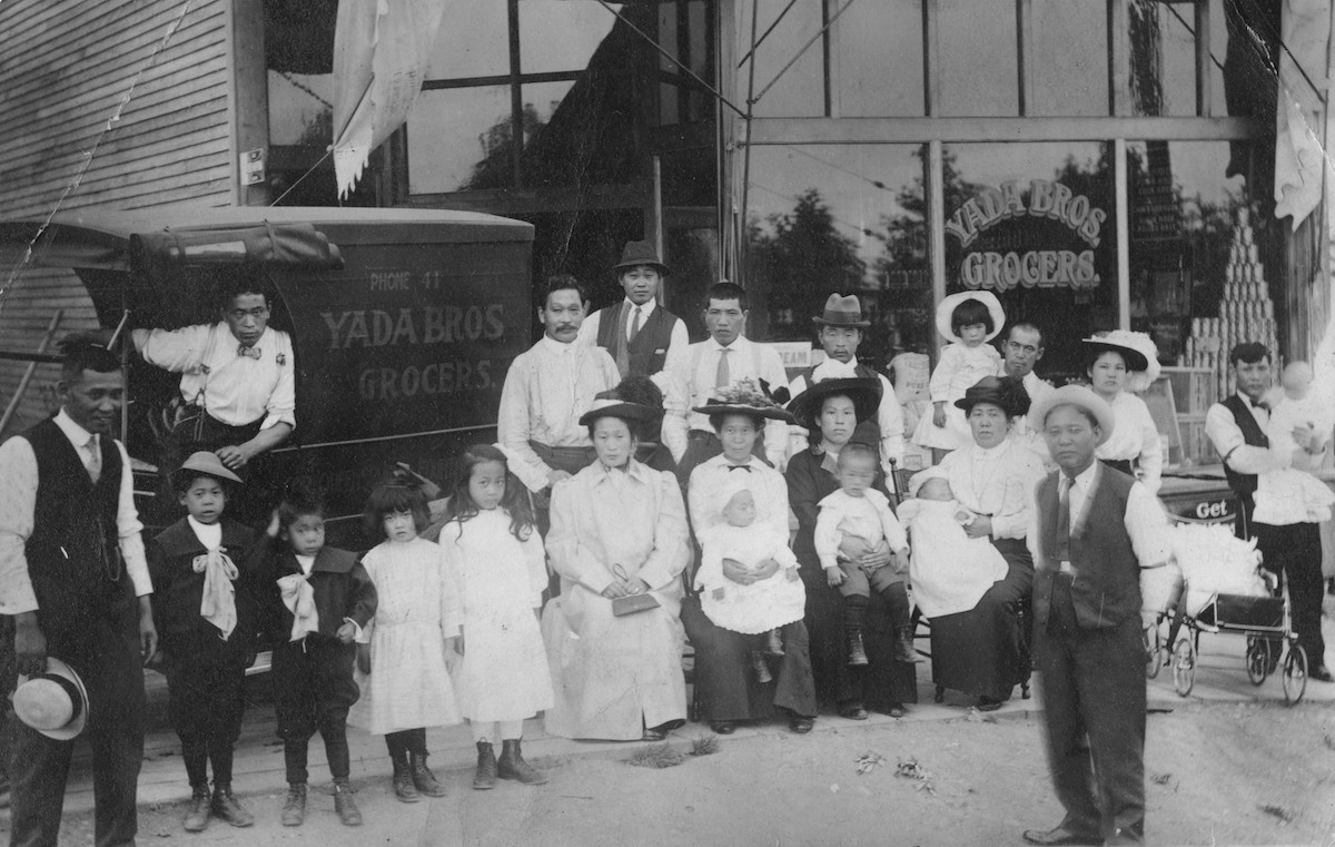 Yada family and relatives in front of Yada Bros. Grocers at 701 E. 4th St., ca. 1913. Finding myself reflected in the archives, means to see members of a racially persecuted Japanese Canadian community. MONOVA Archives, NVMA 9532.