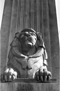 Front view of one of lions by sculptor Charles Marega at south end of Lions Gate Bridge, 1980. NVMA 9676.